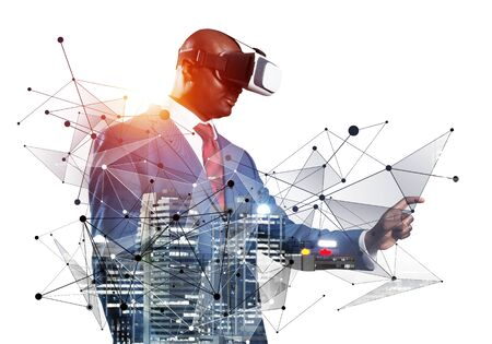African businessman wearing VR headset using futuristic interface. Mixed media with 3d objects. Business model simulation and management. Mixed media with 3d objects. Social network connection model Stockfoto