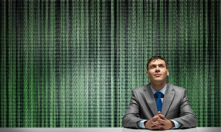 Smiling man folded hands and looking upward. Digital technology for business. Happy businessman sitting at desk. Guy in business suit and tie on abstract digital science fiction matrix like background