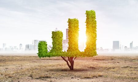 Green plant in shape of growth financial graph in desert. Business analytics and statistics. Friendly ecosystem for business and investment. Nature landscape with dry soil and blue sky. Stok Fotoğraf