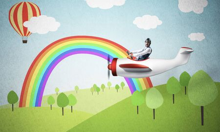 Aviator driving small propeller plane on background of nature landscape. Cartoon summer field with green grass and trees. Aircraft pilot in retro airplane. Rainbow and hot air balloon in blue sky. Stock Photo