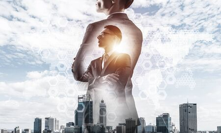 Double exposure of elegant businessman and modern busines city with towers and skyscrapers Archivio Fotografico