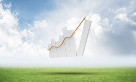 Growing financial graph on green meadow. Business statistics and analytics. Successful stock trading and investment. Beautiful landscape with cloudy blue sky. Mixed media with 3D rendering object. 스톡 콘텐츠