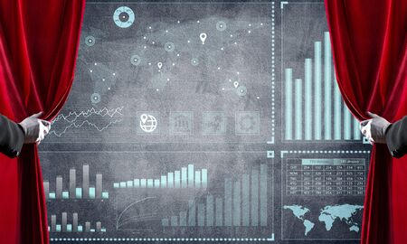 Hand opening red curtain and drawing business graphs and diagrams behind it