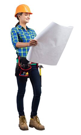 Young civil engineer in orange safety helmet holding paper blueprint. Woman architect in checkered blue shirt and jeans posing on white background. Female professional builder studio shot.
