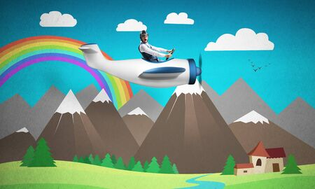 Aviator driving propeller plane on background of mountain landscape. Cartoon summer field with small house and green grass. Aircraft pilot in retro airplane. Rainbow in blue sky above mountain range Imagens
