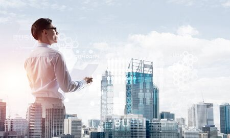 Double exposure of elegant businessman with papers in hands looking away