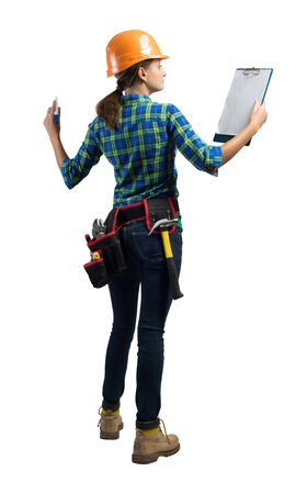 Young architect in workwear isolated on white background. Back view of builder student in orange safety helmet standing with clipboard checklist. Professional architecture audit and management.