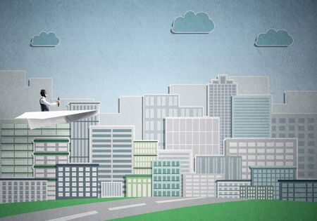 Businessman in aviator hat and goggles sitting in paper plane. Happy pilot driving paper plane on background of cartoon business center with high skyscrapers and office buildings.