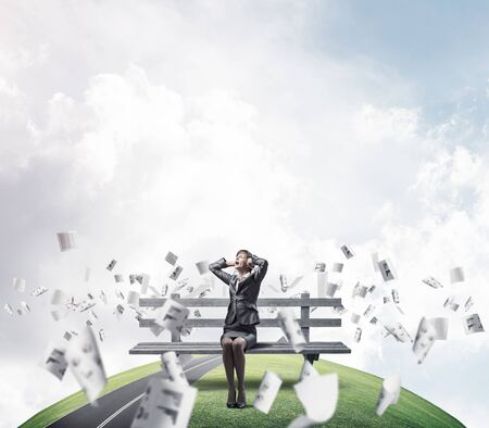 Stressful woman sitting on wooden bench. Emotional screaming girl keeps hands on head. Businesswoman in despair. Panorama with round horizon of world and flying paper documents. Woman call for help.