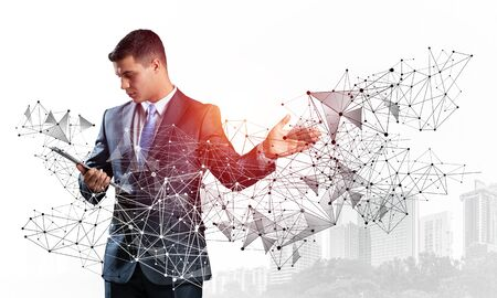 Businessman with documents pointing on abstract network structure. Standing personal assistant in business suit and tie on white background. Global cloud technology and internet communication Banque d'images - 130740892