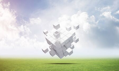 Abstract flying white cubes on green meadow. Virtual reality and digital technology. Hi-tech geometric composition. Nature landscape with green grass and blue sky. Mixed media with 3D rendering object