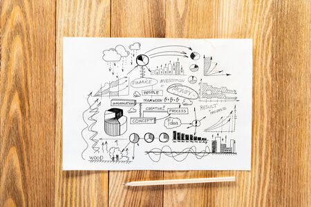 Money management and financial chart pencil hand drawn with group of business doodles. Workplace with paper and pencil lying on wooden desk. Business presentation. Finance and investment concept Фото со стока - 131318924