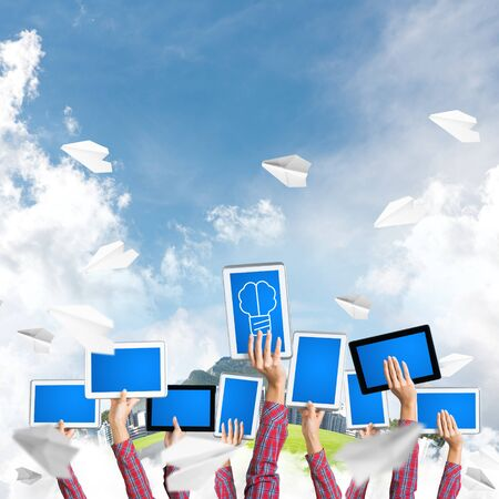 Set of tablets in female hands against modern cityscape background