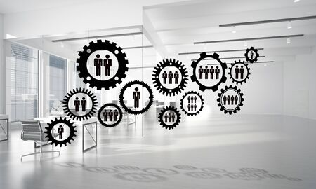 Cogwheels and gears mechanism as social communication concept in office interior. 3D rendering Foto de archivo - 131361351