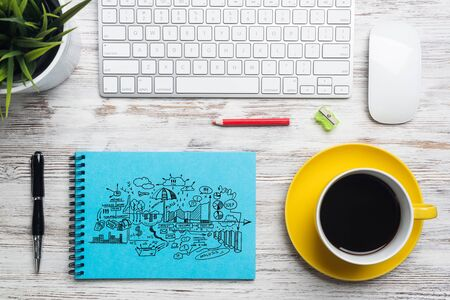 Flat lay wooden desk with computer keyboard, mouse and cup of coffee. Notebook with financial diagrams doodles. Top view modern office workplace. Business analytics and strategy planning. Foto de archivo - 131363354