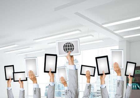 Set of tablets in male hands in modern office interior. 3d rendering