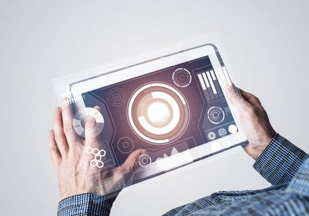 Digital world concept graphic on tablet screen in male hands Banco de Imagens