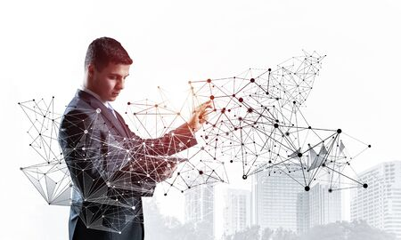 Business person pointing on abstract network structure. Standing personal assistant in business suit and tie on white background. Social connection and networking. Global cloud technology.