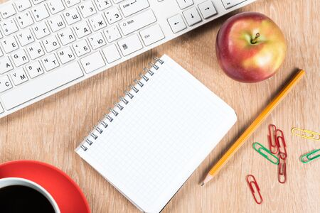 Back to school concept with keyboard blank notepad and pencil