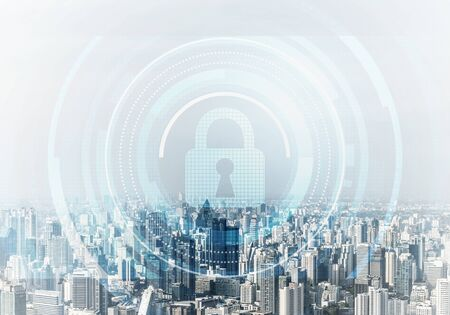 Computer security concept and information technology. Risk management and professional safeguarding. Virtual padlock hologram on background of city skyline. Innovative security solution for business. Stock Photo