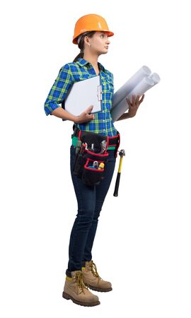 Female civil engineer in safety helmet holding paper blueprints and clipboard