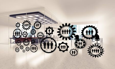 Cogwheels and gears mechanism as social communication concept in office interior. 3D rendering Reklamní fotografie - 133842068