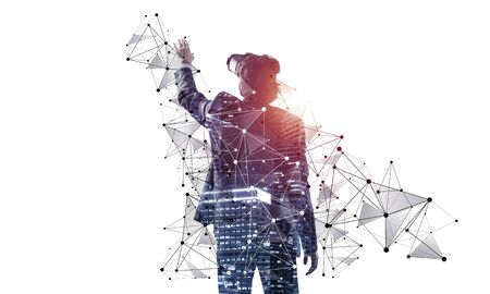 Businessman exploring virtual world, interacting with digital interface. Man in suit wearing VR goggles and gesturing in air. Studio photo by back view man on white background. New cyber reality.