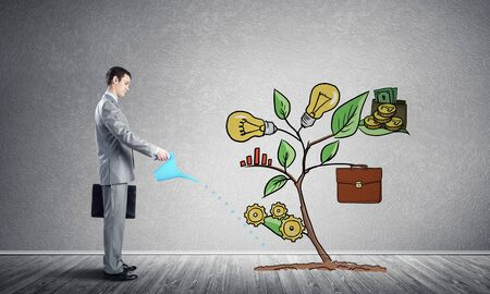 Businessman watering drawing tree with can. Green plant consisted of business infographic signs. New startup development. Business support and assistance metaphor. Investing into ideas. Stockfoto - 134035190