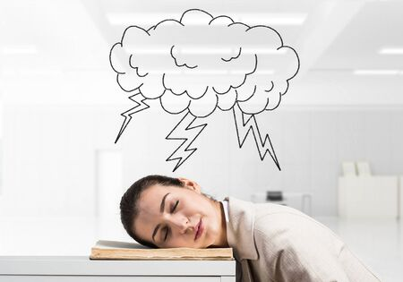 Exhausted business woman sleeping on desk. Cloud with lightning above head. Tired corporate employee relaxing in office. Difficult situation at workplace. Deadline and overwork concept. Stock Photo