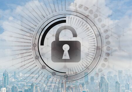 Computer security concept and information technology. Risk management and professional safeguarding. Virtual padlock hologram on background of city skyline. Innovative security solution for business. Stock fotó