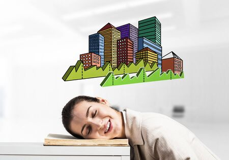 Happy business woman sleeping on workplace. Downtown with skyscrapers cartoon drawing above head. Smiling female worker in white suit dreaming in office. Real estate agency advertising. Фото со стока