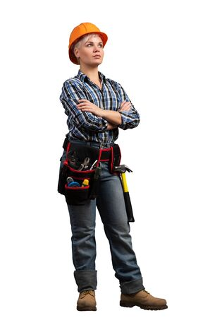 Attractive female construction worker in hardhat standing with folded arms. Confident young specialist in checkered blue shirt isolated on white background. Industrial manufacturing and construction