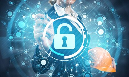 Digital cybersecurity and network protection concept. Virtual locking mechanism to access shared resources. Interactive virtual control screen with padlock. Business woman pointing on padlock hologram 版權商用圖片