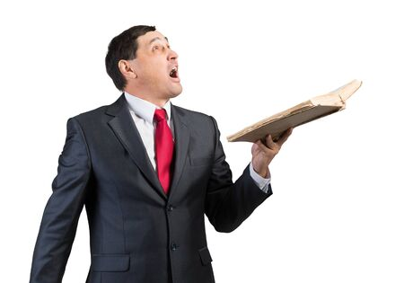 Surprised businessman holding open book and looking up. Startled adult man in business suit and tie standing on white background. Education and knowledges. New and actual information concept Stock fotó