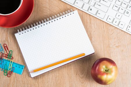 Back to school concept with keyboard blank notepad and pencil Standard-Bild - 138459436