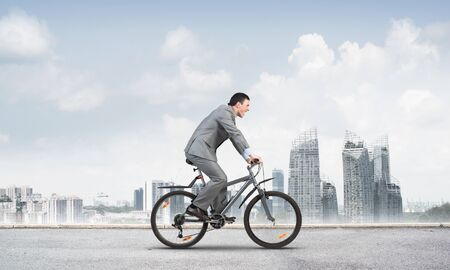 Businessman commuting to work by bike.