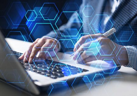 Innovation technology in modern corporate business concept. Virtual geometric graphics with hexagon elements. Businessman working at laptop computer on background. Abstract global network connection