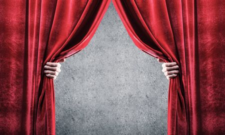 Close up of businessman hand open red velvet curtain. Place your text Archivio Fotografico