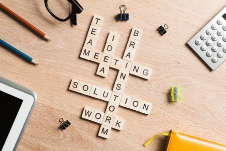 Words of business marketing collected in crossword with wooden cubes Archivio Fotografico