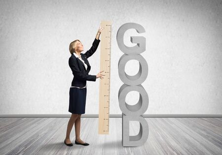 Woman holding big ruler on wall background. Business development to success. Businesswoman measuring something with ruler. Human resources recruitment. Creative motivation, coaching and mentoring.