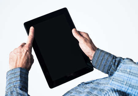 Close up of businessperson using digital tablet with blank display Banco de Imagens