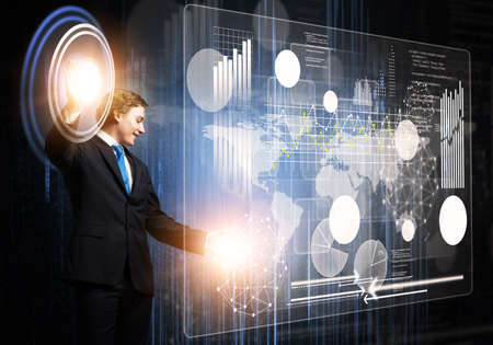 Innovation technology in modern corporate business. Businessman touching virtual interface with financial analytics. World economy trends concept. Forex market statistics and online stock trading.