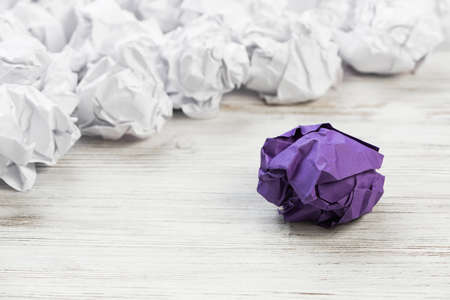 Set of crumpled paper balls with one colorful Imagens