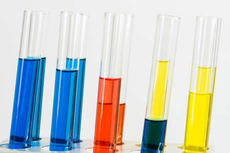 Science laboratory research and development. Close up test tubes with colorful substance on white background. Chemical manufacture concept with glass equipment. Modern biotechnology industry.