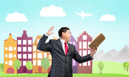 Expressive businessman holding open book. Emotional adult man in business suit standing on city illustration background. Excited manager shouting into handbook. Professional reference information