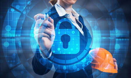 Virtual locking mechanism to access shared resources. Businesswoman pointing on padlock hologram. Internet concept for identity and access management. Future cyber technology web services for business