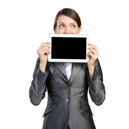 Businesswoman with tablet computer looking away. Portrait of attractive woman in formalwear showing tablet PC near her face. Corporate businessperson and digital technology layout with copy space 版權商用圖片