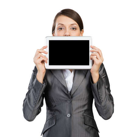 Businesswoman holding tablet computer with blank screen. Beautiful woman in business suit show tablet PC near her face. Corporate businessperson isolated on white background. Digital technology layout Stok Fotoğraf