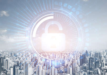 Computer security concept and information technology. Risk management and professional safeguarding. Virtual padlock hologram on background of city skyline. Innovative security solution for business. Stok Fotoğraf