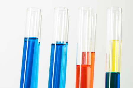 Laboratory analysis and testing. Close up test tubes with colorful reagents on white background. Scientific concept with glass chemical equipment. Pharmaceutical industry research and experiments Banco de Imagens